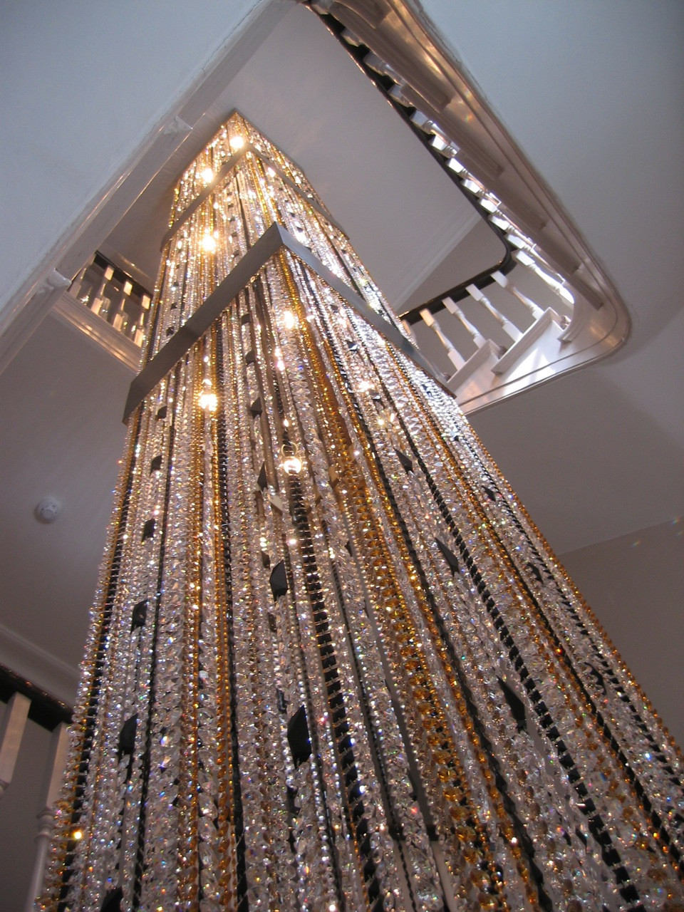 STAIRWELL CRYSTAL LIGHT SCULPTURE IN AMBER AND JET CRYSTAL